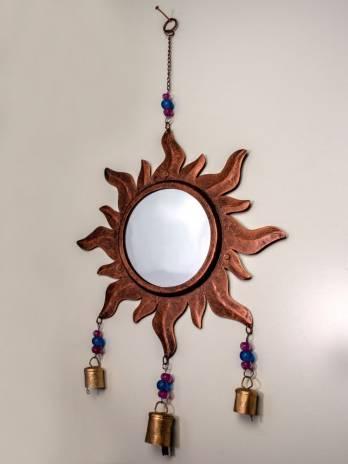 Colgador con espejo de sol